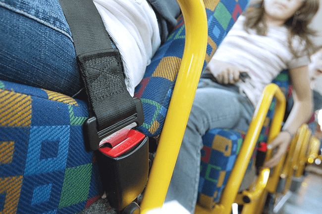 Folk på buss. Foto.
