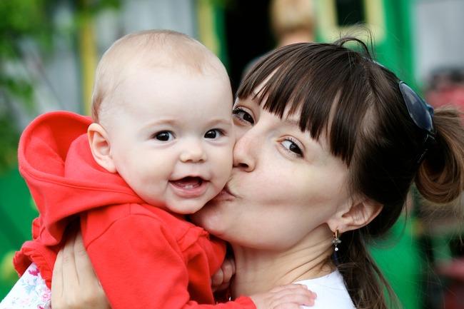 Baby og mor.Foto